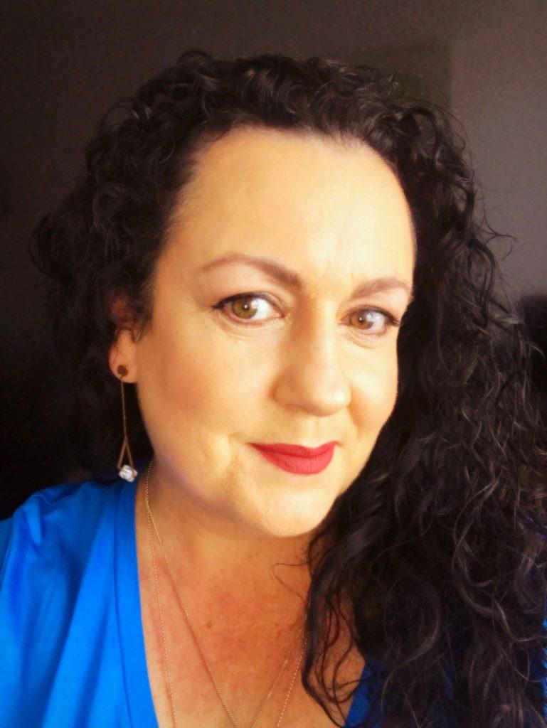 Hi I'm Julia George, a Brisbane, Australia-based psychic medium, psychotherapist, modern witch and healer